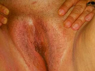Wife's wet clean shaved pussy.