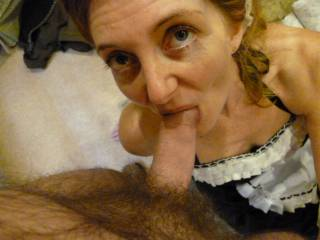 taking a break from cleaning and giving hubby a quick blowjob.