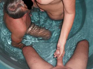 Threesome fun in our spa at home. Our swinger friend plays with me in the water, whilst I play with my Hubby's lovely smooth thick cock.