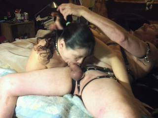 Grabbing her hair as she gives me another great blowjob.